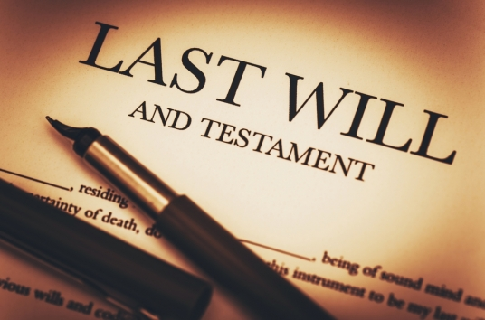 """{Image: A sheet of beige paper with the title """"LAST WILL AND TESTAMENT.""""  There is an uncapped fountain pen placed on the paper.}"""