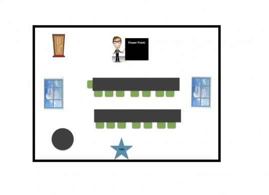 A computer drawing of a room with a man standing at the front of the room smiling with a power point to his left.  There is a door to his right and two long rectangular tables in front of him with chairs facing the man.  There are windows on either side of the room and a brown circle in the bottom left corner. There is a blue star at the center bottom of the image with the word