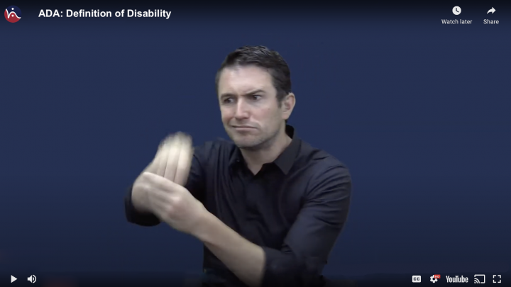 Image of a man signing into the camera. The HKNC logo is at the top left hand corner followed by the wording ADA: Definition of Disability
