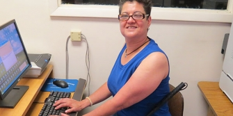 Woman sitting a computer