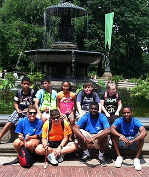 Campers pose in front of a fountain on a field trip to Central Park in NYC