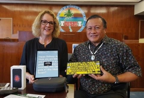 Cathy with Ben Servino, director of the Department of Integrated Services for Individuals with Disabilities in Guam and Guam's liason with HKNC. Photo credit: The Guam Daily Post
