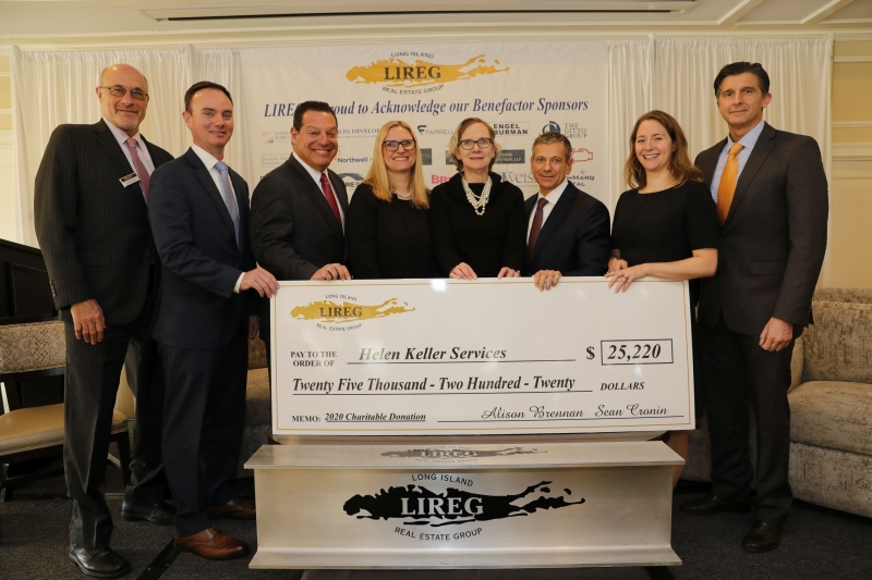 LIREG Executive Board presenting an oversized check to Helen Keller Services for the Blind for the Low Vision Center improvements.